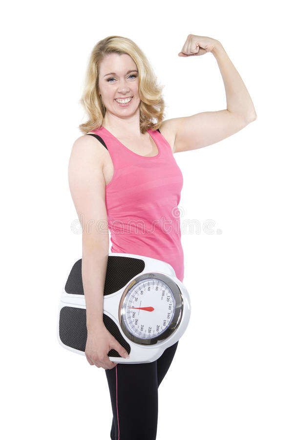 Smiling adult female holding scale royalty free stock photography