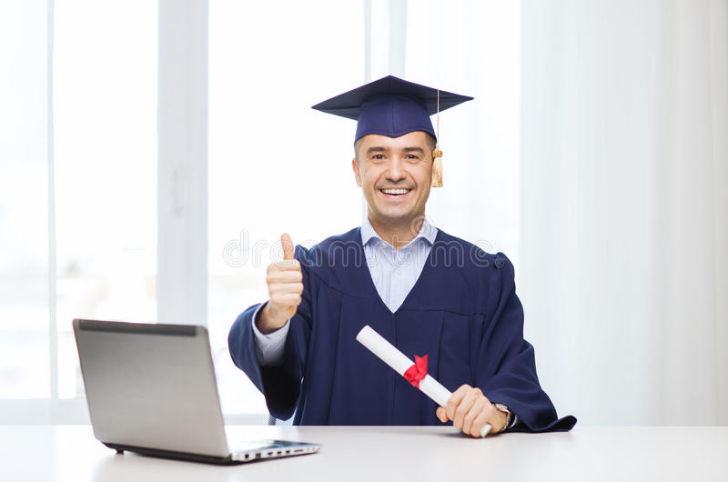 Smiling adult student in mortarboard with diploma stock photography