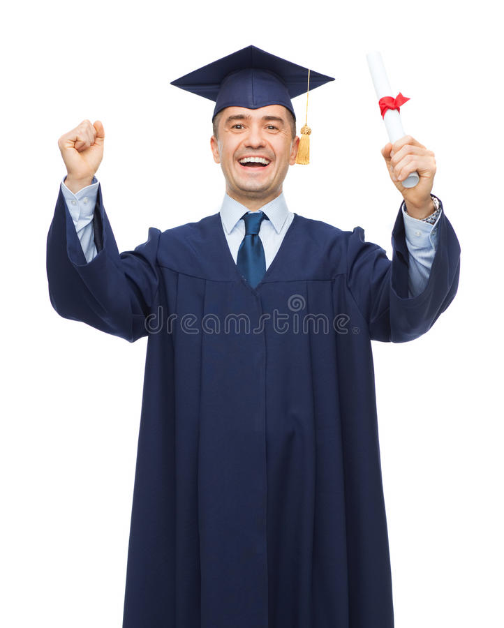 Smiling adult student in mortarboard with diploma royalty free stock photography