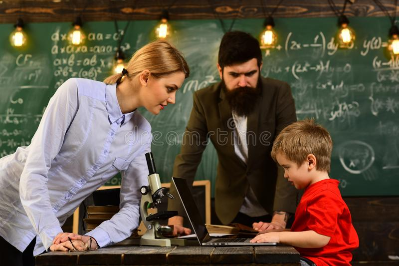 Smiling adult students during break in classroom interior, Talented coach during workshop indoors - productive training. In stylish college interior, Private royalty free stock photography