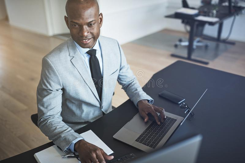 Two diverse businesspeople working on a computer in an office stock images