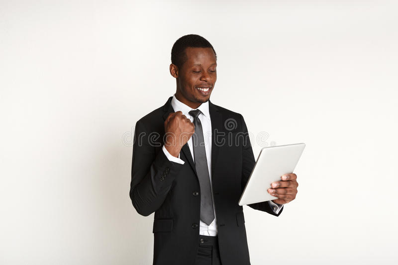 Smiling african american businessman using tablet. royalty free stock images