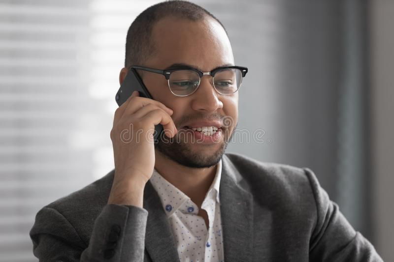 Smiling African American businessman talking on phone close up royalty free stock photos