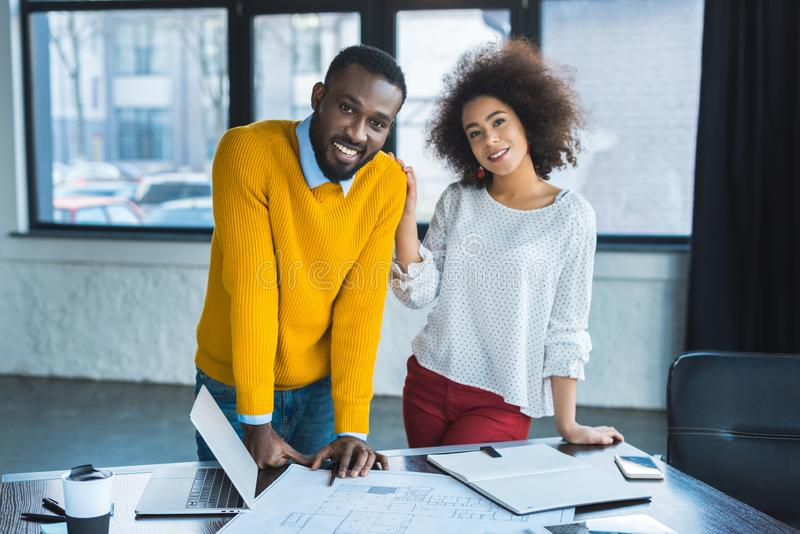 smiling african american businesspeople looking stock image