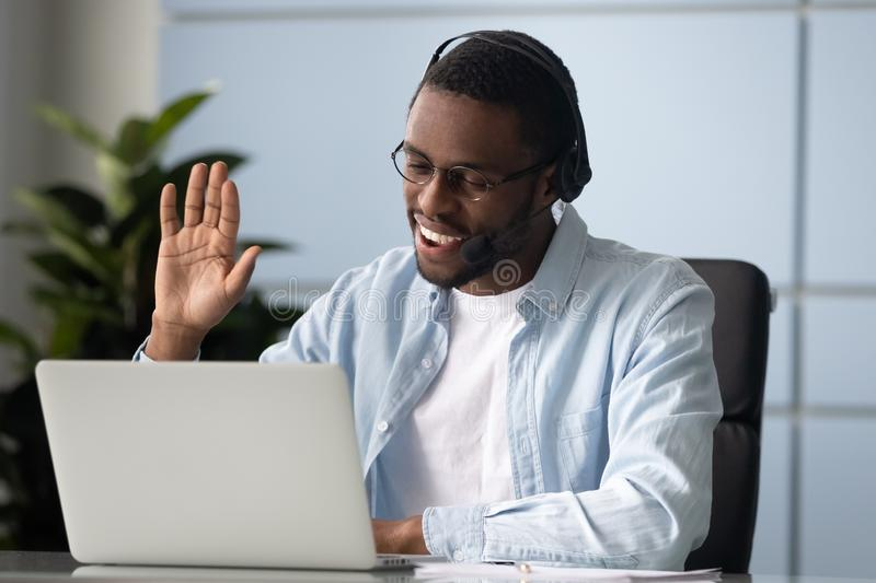 Smiling african american entrepreneur holding video call with clients. stock photo