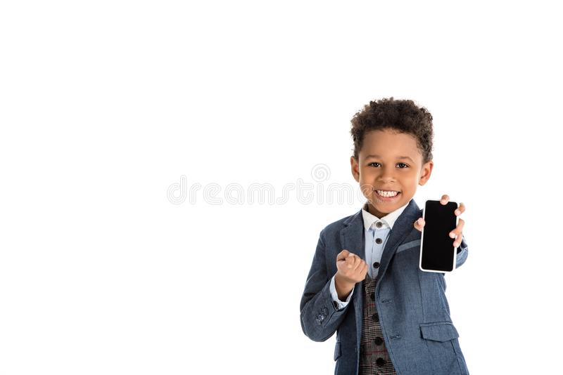 smiling african american kid showing smartphone royalty free stock photo