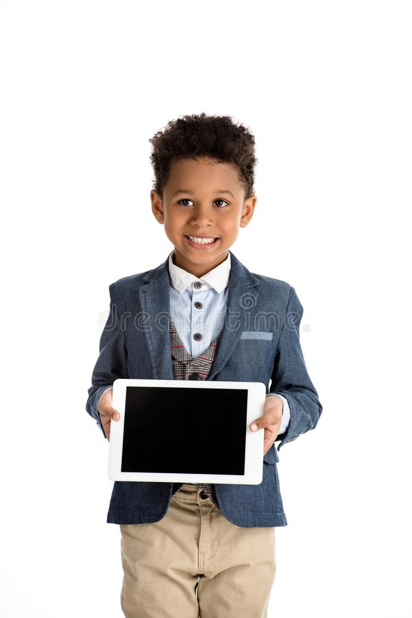 smiling african american kid showing tablet royalty free stock photography