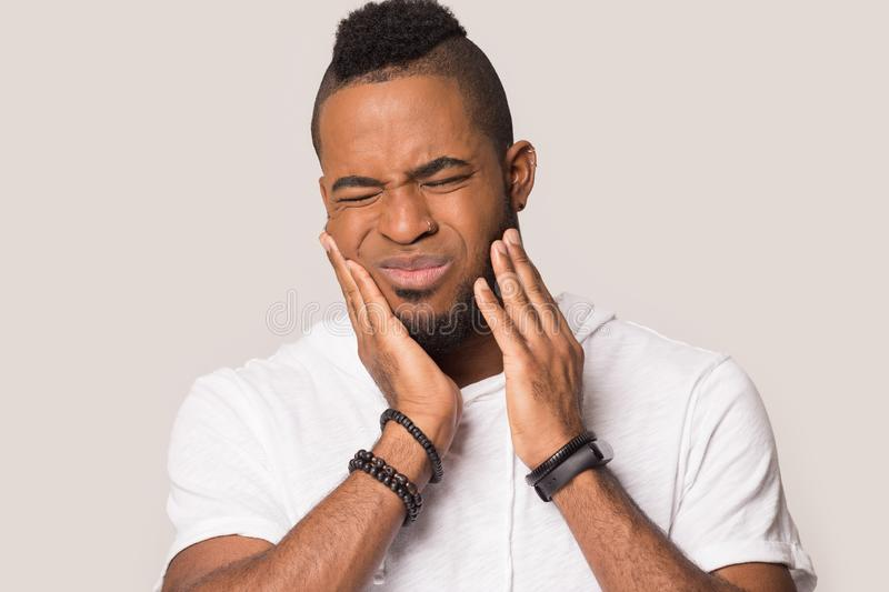 Smiling black man show call me gesture isolated in studio. Smiling african American male in glasses show phone gesture ask call back, happy black millennial man stock photo