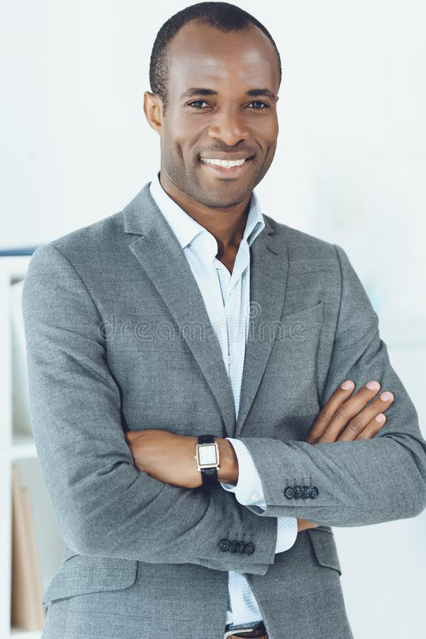 smiling african american man with crossed arms looking royalty free stock photo