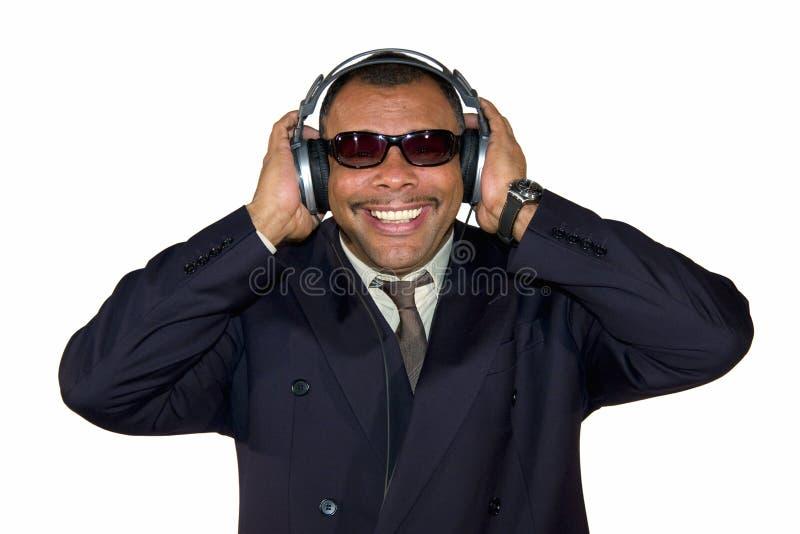 Download Smiling African-American Man With Headphones Stock Photo - Image of formal, earphones: 13109792