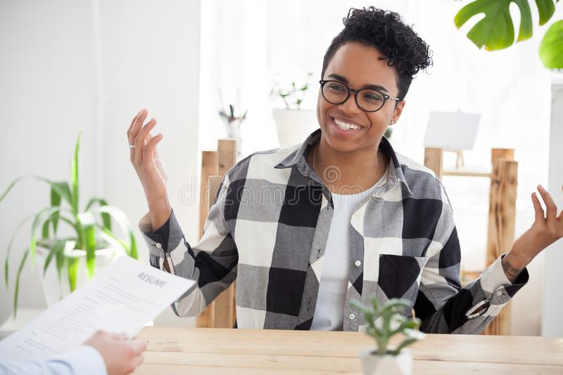 Happy black girl smile talking at office interview stock image