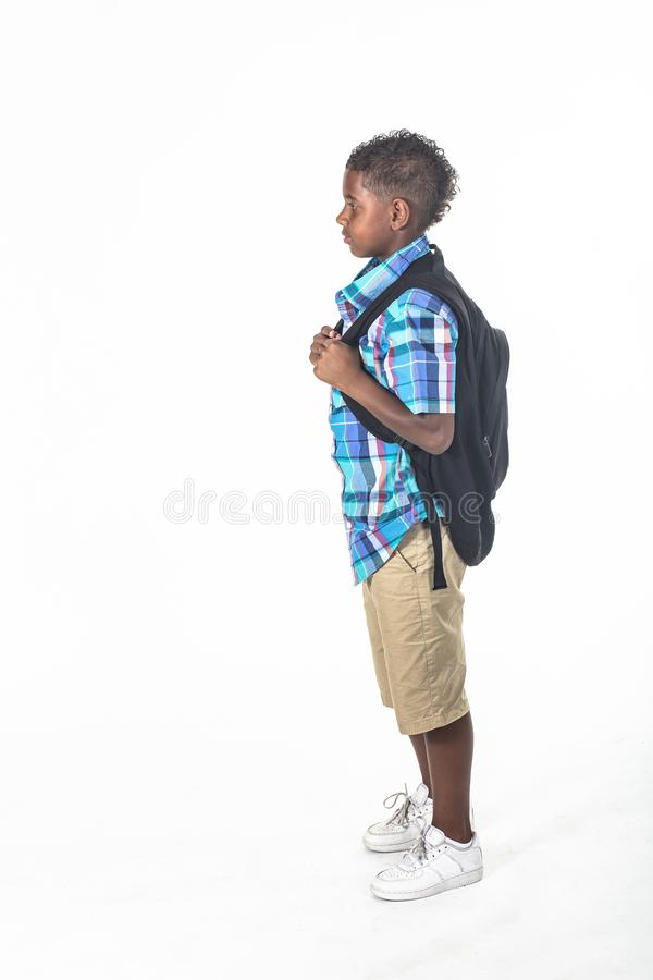 African American school boy with backpack  on white royalty free stock photography