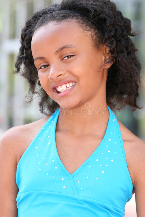 Download Smiling African American Teenager Girl Stock Photo - Image of smiling, portrait: 10142796