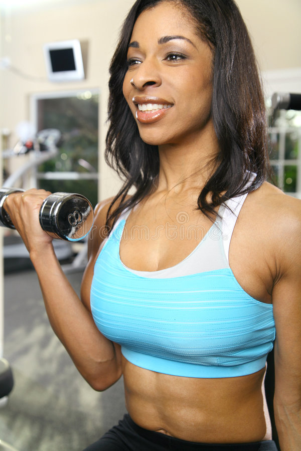 Smiling African American Woman Working Out royalty free stock image