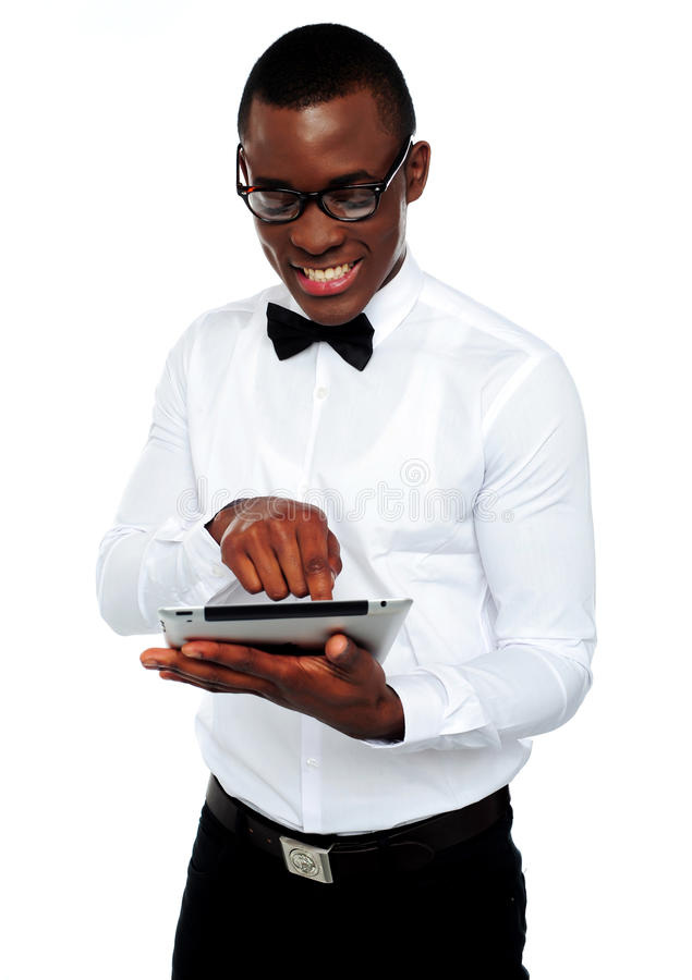 Download Smiling African Boy Using Tablet-pc Royalty Free Stock Photography - Image: 25231387