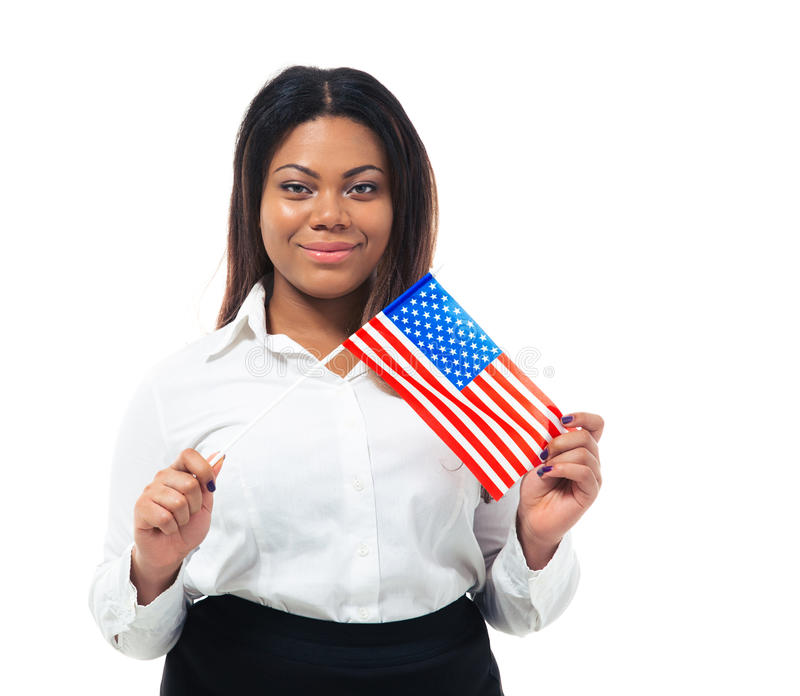 Smiling african busiensswoman holding US flag. Isolated on a white background. Looking at camera stock photo