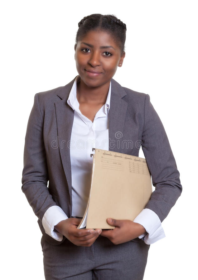 Smiling african business woman with file. On an isolated white background for cut out royalty free stock image