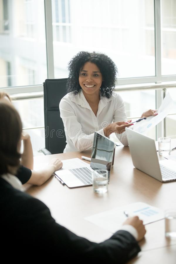 Smiling african businesswoman sharing good result meeting partne royalty free stock image
