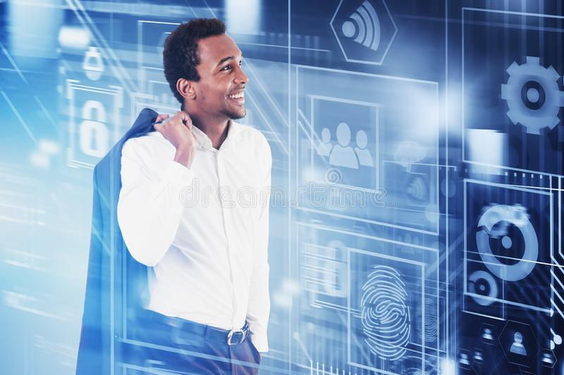 Smiling African man looking at business interface royalty free stock image