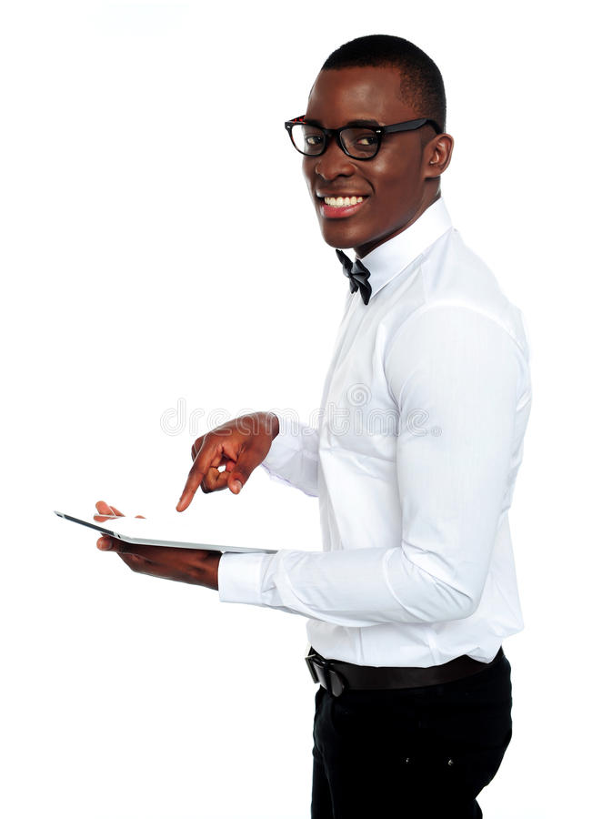 Download Smiling African Operating Touch-pad Device Stock Image - Image: 25231391