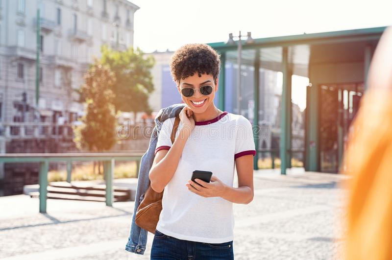 African girl using smartphone on road royalty free stock photo
