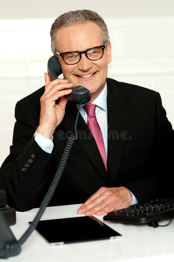 Download Smiling Aged Man Communicating With His Client Stock Image - Image: 26097811