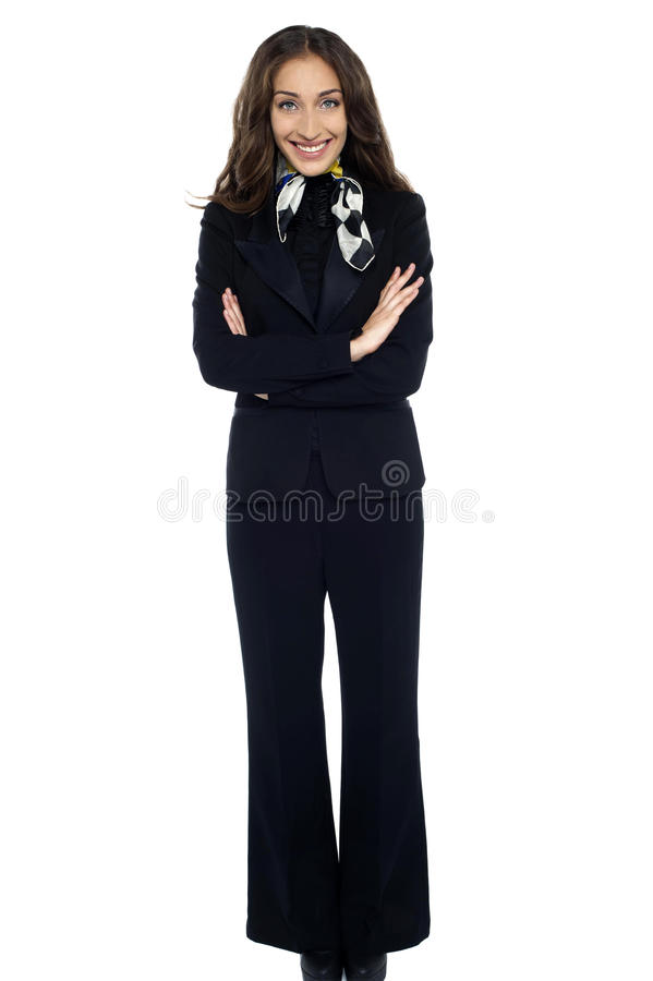 Smiling Air Hostess Standing With Arms Crossed Royalty Free Stock Images