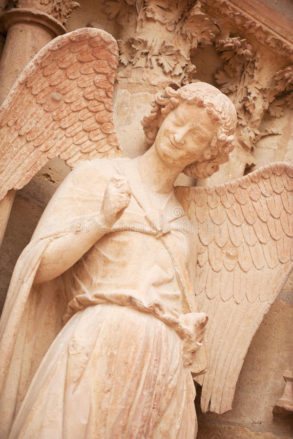 Smiling angel. Famous smiling angel on facade of Reims Cathedral royalty free stock photography