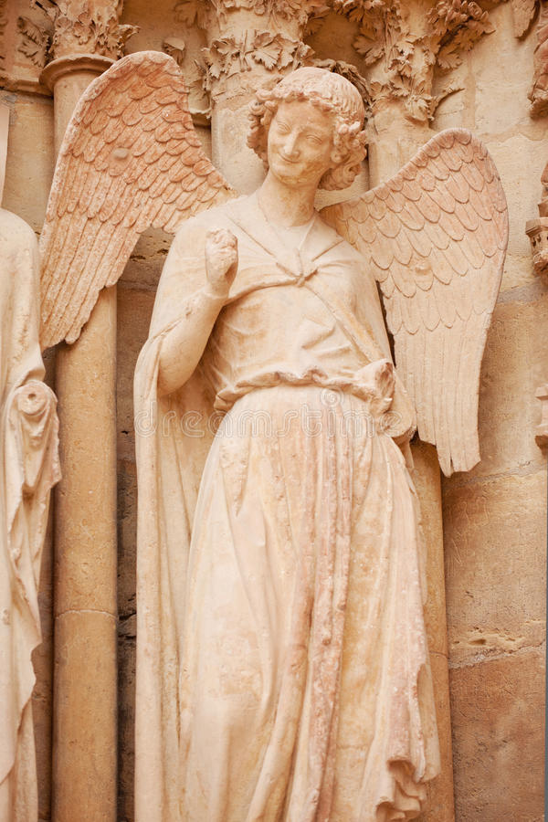 Smiling angel. Famous smiling angel on facade of Reims Cathedral stock photos