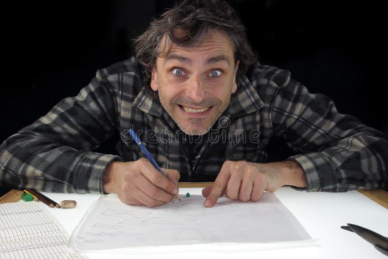 Smiling animator. Animator drawing on light box stock photography