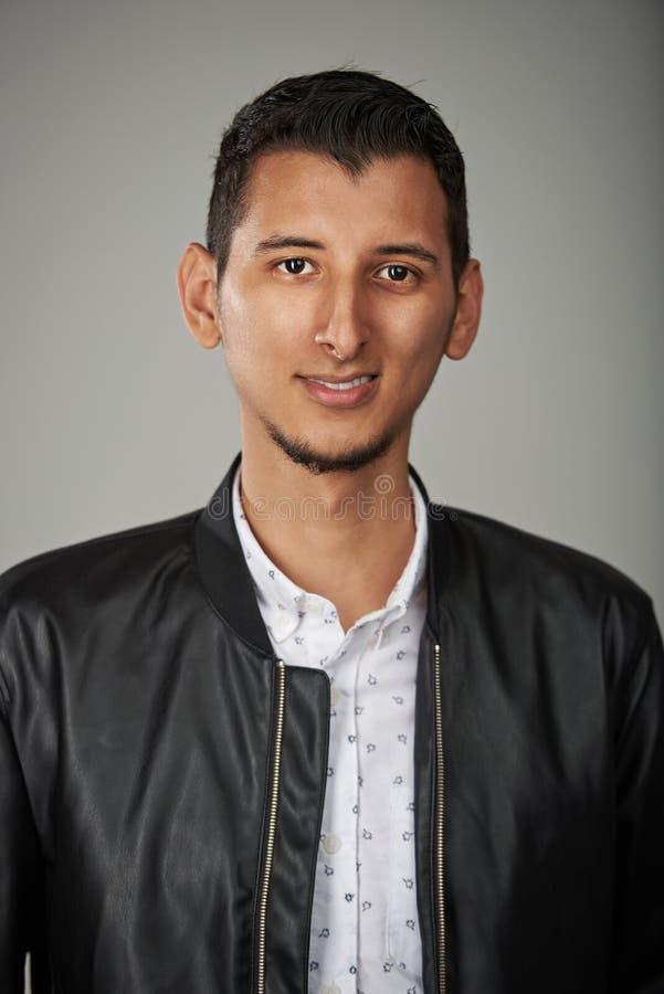 Smiling arab young man stock image