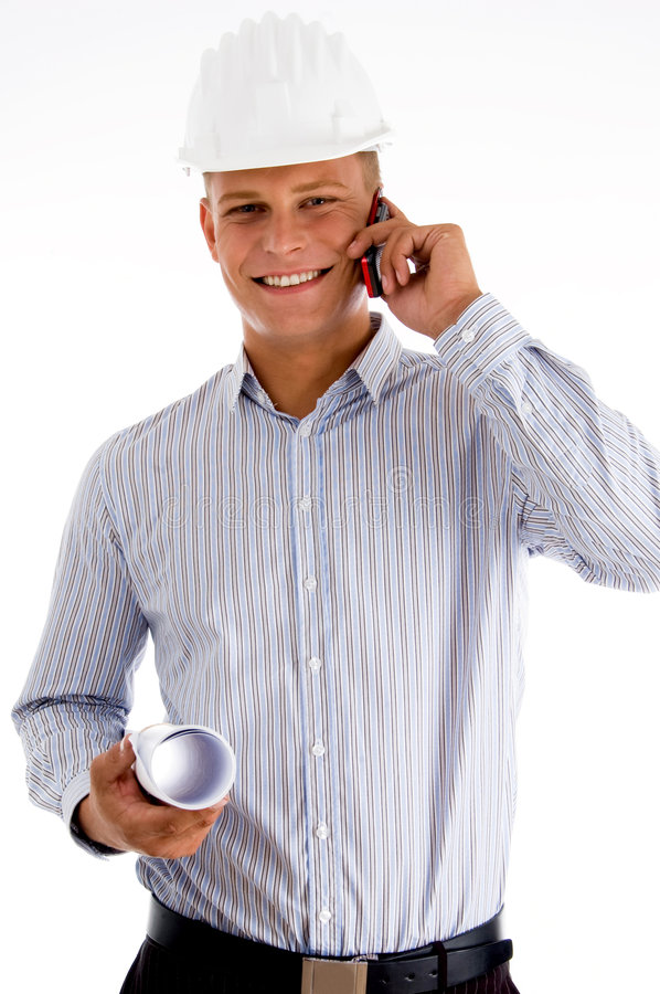 Smiling architect busy on mobile stock photography