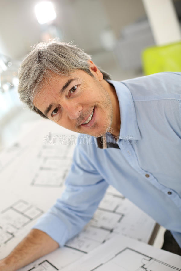Smiling architect at office working on project stock images
