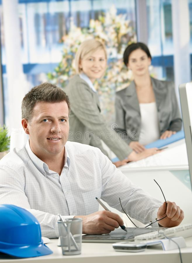 Download Smiling Architect Sitting At Work Stock Photo - Image: 27720742