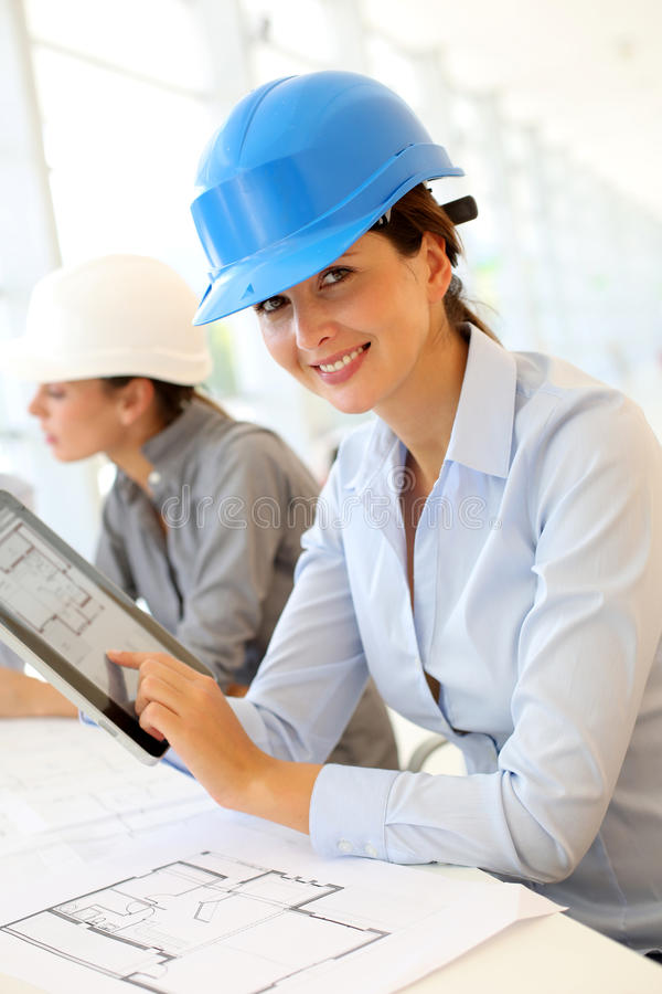 Download Smiling architect at work stock image. Image of architecture - 27181315