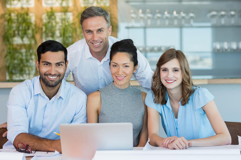 Smiling architects sitting together in office stock photos