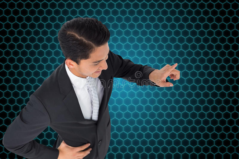Smiling asian businessman pointing. Composite image of smiling asian businessman pointing stock images