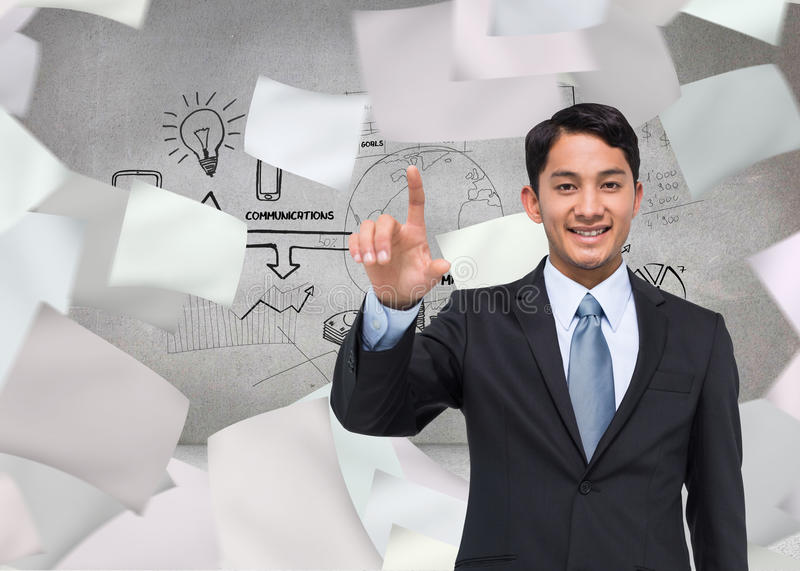 Smiling asian businessman pointing. Composite image of smiling asian businessman pointing royalty free stock photo