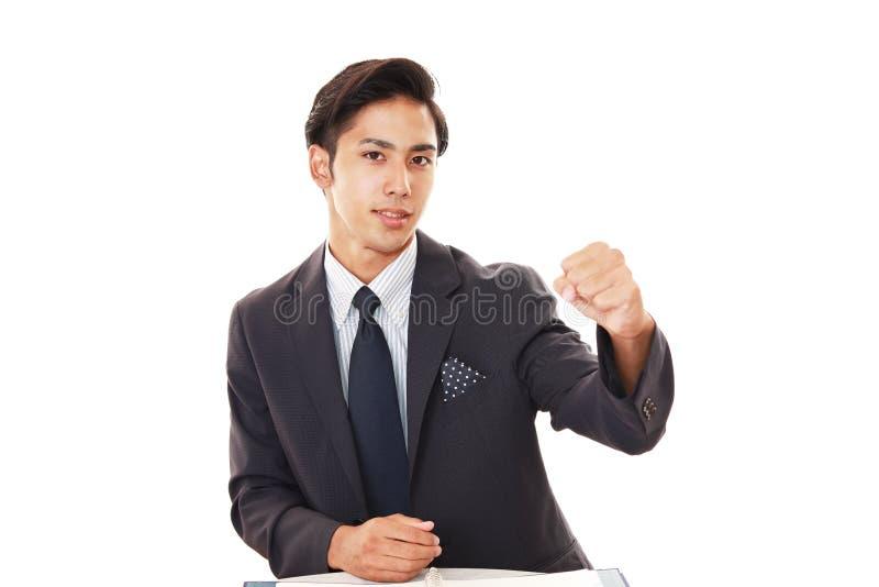 Smiling Asian businessman stock photos