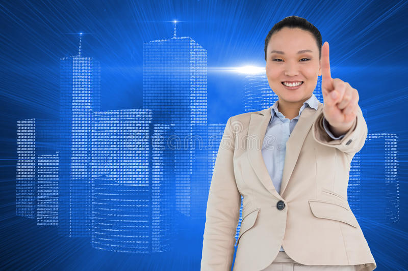 Smiling asian businesswoman pointing. Composite image of smiling asian businesswoman pointing royalty free stock photos