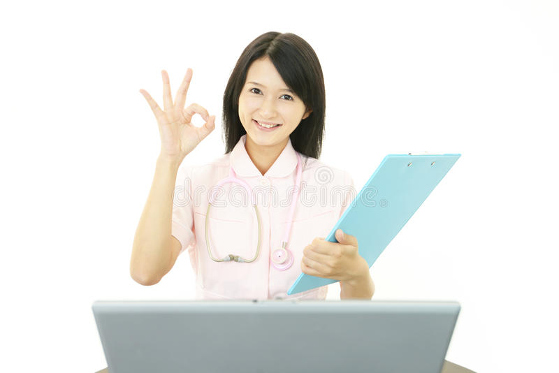 Download Smiling Asian female nurse stock photo. Image of excitement - 39510114