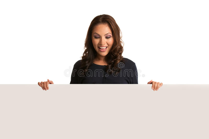 Smiling Asian Female Pointing To A Blank Board Stock Images