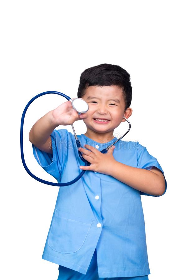 Smiling Asian kid in blue medical uniform holding stethoscope isolated on white with clipping path. Smiling Asian Thai kid in blue medical uniform holding stock photos