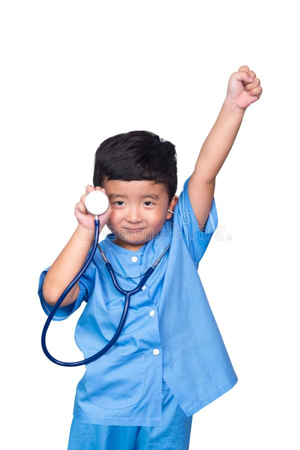 Smiling Asian kid in blue medical uniform holding stethoscope isolated on white with clipping path stock photos