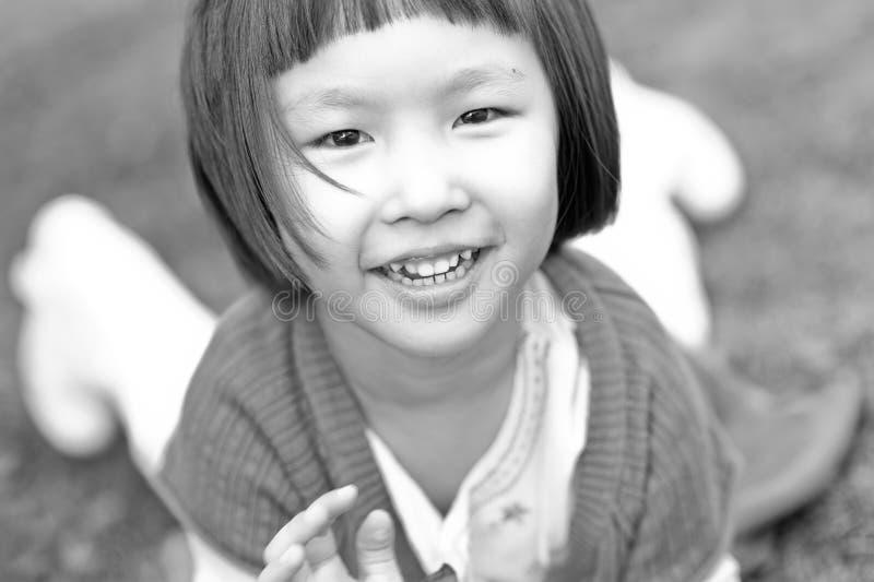 Smiling asian little girl stock photos