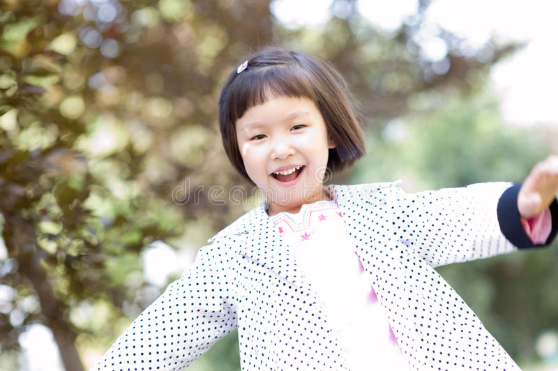 Download Smiling asian little girl stock photo. Image of black - 11766092