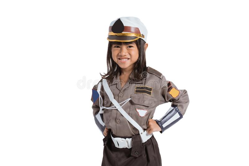 Smiling asian little girl wearing a police uniform with two hands on her waist stock photo