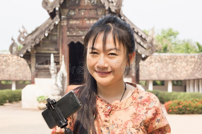 Smiling Asian long hair women with smartphone , portrait beautiful Asian lady with temple background stock photos