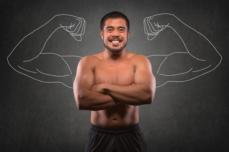 Smiling asian man with muscular upper body in front of muscle arms background. Fitness, workout and training concept.  royalty free stock photos