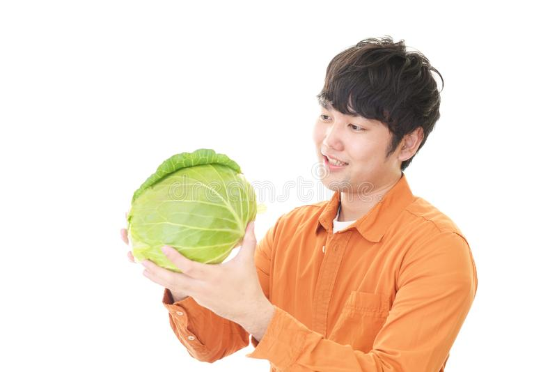 Asian man with vegetable. Smiling Asian man with vegetable stock photos